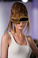 Model walks the runway in an outfit from the Dramatik Fanatic runway show, during BK Fashion Weekend Spring Summer 2012.