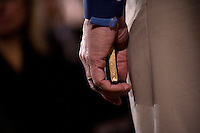 While speaking at a town hall meeting in Northfield, New Hampshire, former congressman Rick Santorum holds on to a gilt-edged copy of the US Constitution that he keeps in his pocket.  Santorum is seeking the 2012 Republican nomination for president.