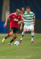 July 16, 2010 Gabriel Obertan No. 26 of Manchester United and Charles Mulgrew No. 21 of Celtic FC during an international friendly between Manchester United and Celtic FC at the Rogers Centre in Toronto.