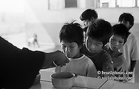 Brazil. Kaiowas Indigenous People. Indigenous school. Afternoon snack. Jaguapiré village. City: Tacuru, State: Mato Grosso do Sul.
