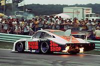 The Porsche 935 driven by John Paul, Jr., and Preston Henn during the 1983 IMSA race at Road America near Elkhart Lake, Wisconsin.