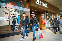 Last minute shoppers outside the Zumiez store in the Queens Center Mall in the borough of Queens in New York on Christmas Eve, Saturday, December 24, 2016. A study reports that the holiday shopping season, November and December, now accounts for less than 21 percent of physical stores' sales, down from its peak of 25 percent. (© Richard B. Levine)