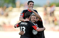 Chris Pontius (13) of D.C. United celebrates with teammate Nick DeLeon and John Thorrington his score. D.C. United defeated the The New England Revolution 3-1 in the Quarterfinals of Lamar Hunt U.S. Open Cup, at the Maryland SoccerPlex, Tuesday June 26 , 2013.