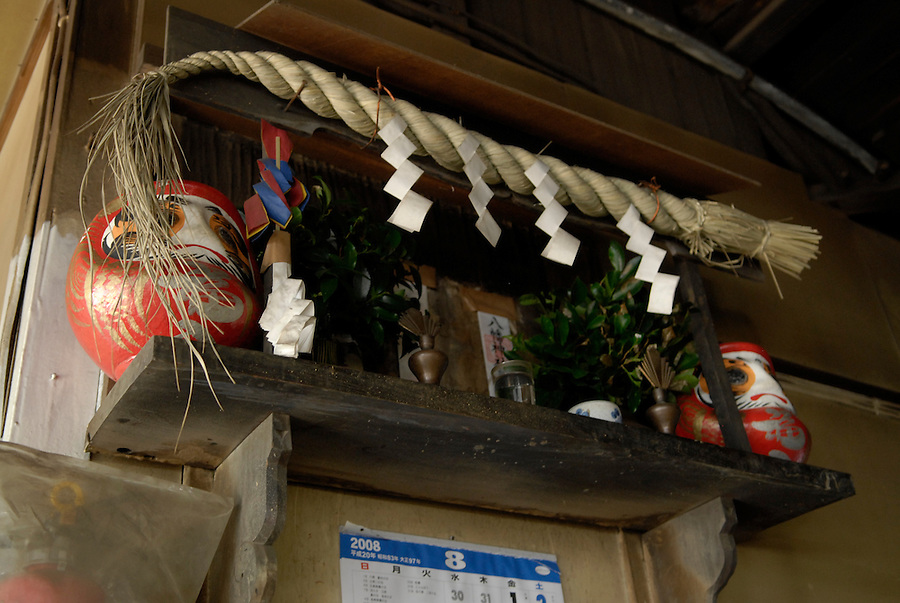 A small Shinto shrine on the wall in the Takahashi knife workshop.The company makes cooking knives for the shop in Tsukiji fish market..
