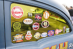 These decals are on side window of A. Racine's 1955 Chevrolet sedan, a Gasser A/Gas class racing car, at the 58th Annual Easter Sunday Vintage Car Parade and Show sponsored by the Garden City Chamber of Commerce. Hundreds of authentic old motorcars, 1898-1988, including antiques, classic, and special interest participated in the parade.