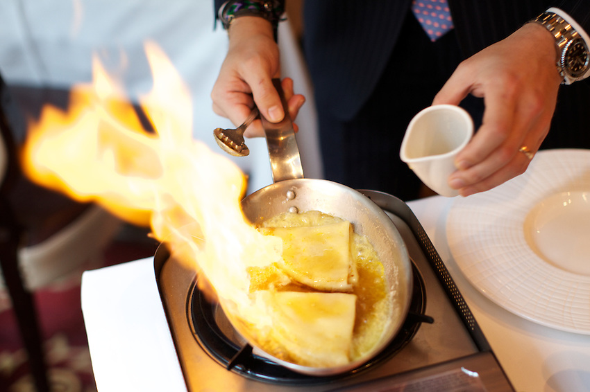NEW YORK, NY - OCTOBER 11, 2013: Flaming Crepes Suzettes table side at Le Cirque. CREDIT: Clay Williams for Zagat.<br /> <br /> <br /> &copy; Clay Williams / http://claywilliamsphoto.com