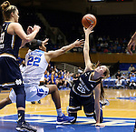 01 February 2016: Notre Dame's Madison Cable (right) and Duke's Oderah Chidom (left) challenge for a loose ball. The Duke University Blue Devils hosted the University of Notre Dame Fighting Irish at Cameron Indoor Stadium in Durham, North Carolina in a 2015-16 NCAA Division I Women's Basketball game. Notre Dame won the game 68-61.