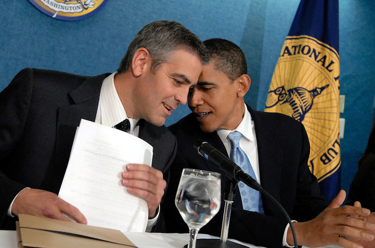 """Sen. Barack Obama, D-Ill., left, has a word with actor George Clooney at the National Press Club for """"SAVE DARFUR: Rally to Stop Genocide.""""  Clooney discussed he and his father's recent visit to the region.  Sam Brownback, R-Kan., also appeared."""