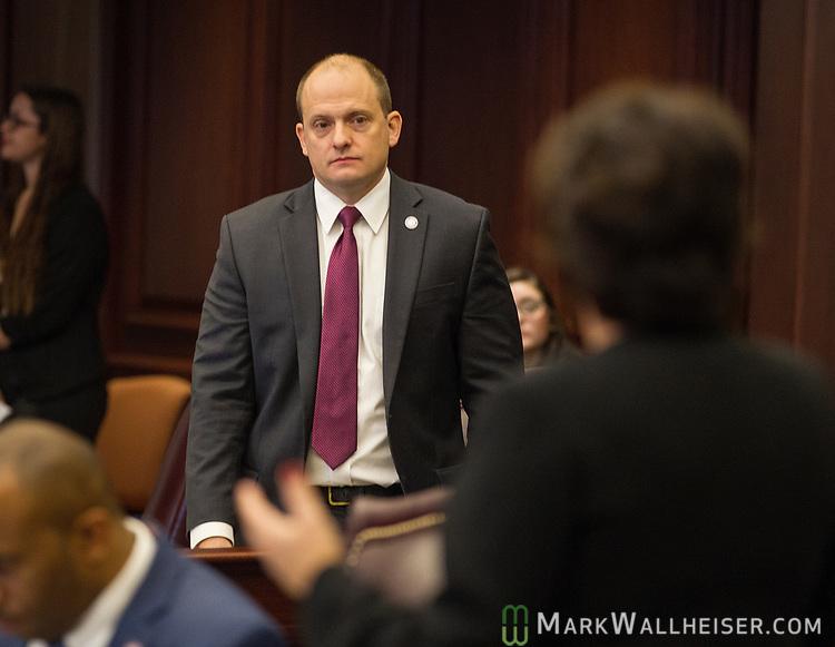 Sen. Jose Rodriguez, D-Miami, listens to Sen. Kathleen Passidomo, R-Naples, during Senate debate at the Florida Capitol in Tallahassee, Florida.