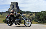 HULETT, WYOMING - AUGUST 2010:  Motorcyclists ride past Devils Tower near Hulett, Wyoming during the 70th annual Sturgis Motorcycle Rally held in the Black Hills of South Dakota.  The attendance estimates were placed between 500, 000 and 700,000 bikers.