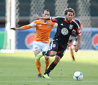 Nick DeLeon (28) of D.C. United goes against Brad Davis (11) of the Houston Dynamo. The Houston Dynamo defeated D.C. United 2-1, at RFK Stadium, Saturday October 27, 2013.