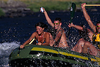 Tasting triumph over the rapids, Rogue River rafters join some 100,000 other day trippers who paddle, float, or kayak the river each year. Nightfall brings tranquility; only a few lucky winners of BLM's annual lottery can continue into the Wild and Scenic portion as it rushes toward the Pacific Ocean near Gold Beach, Oregon.