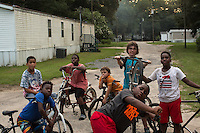 The neighborhood bike crew at Ravenel Mobile Home Park. They all miss riding bikes with Armani Mungin, 8. RAVENEL, SC on Thursday, July 7, 2016. (Justin Cook)