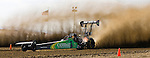 Scott Whipple races Geoff Gill for the top-fuel championship at the National Sand Drad Race Association's 2009 Summer Nationals in Avenal, CA May 17, 2009.