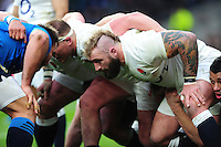 Joe Marler of England prepares to scrummage against his opposite number. RBS Six Nations match between England and Italy on February 26, 2017 at Twickenham Stadium in London, England. Photo by: Patrick Khachfe / Onside Images