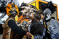 Members of the Zulu Social Aid and Pleasure Club take a moment to pose while preparing for the Krewe of Zulu Parade on Mardi Gras day near Claiborne Avenue in New Orleans, Louisiana, USA.