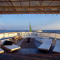 The decking at the rear of Alberta Ferretti's houseboat offers generous seating in a simple yet elegant setting