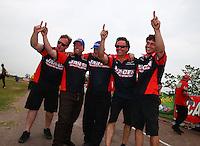 Apr 27, 2014; Baytown, TX, USA; NHRA pro mod driver Mike Janis celebrates with crew after winning the Spring Nationals at Royal Purple Raceway. Mandatory Credit: Mark J. Rebilas-