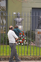 A father showing his son the statues of the South American independence heroes displayed behind an iron fencing Montevideo, Uruguay, South America