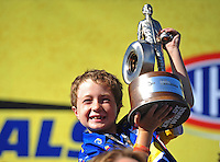 Jul. 31, 2011; Sonoma, CA, USA; Caden Capps the sun of NHRA funny car driver Ron Capps (not pictured) celebrates after winning the Fram Autolite Nationals at Infineon Raceway. Mandatory Credit: Mark J. Rebilas-