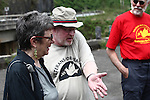 Chris Jaminson relates to Elaine Elinson an anecdote about his service during the Vietnam War, as fellow veteran Mike Kerber looks on. Jaminson spent a month in 1970 as an Army M42 Duster crewman helping South Vietnamese troops guard a bridge on Highway 9, near the former Demilitarized Zone. South Vietnamese troops used to fish in the river below with hand grenades, Jaminson said. The three toured Vietnam in April with Veterans for Peace, learning about efforts to mitigate the suffering of Agent Orange victims and others who have been maimed by land mines and bombs left over from the war. April 24, 2013.