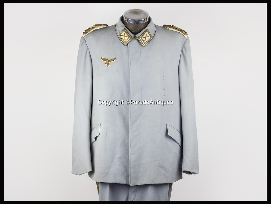 BNPS.co.uk (01202 558833)<br /> Pic: ParadeAntiques/BNPS<br /> <br /> The Hermann Goring suit.<br /> <br /> The sweat-stained uniform of one of World War Two's most ruthless Nazis has been discovered.<br /> <br /> The well worn outfit of Hermann Goering, who founded the Gestapo and was commander of the Nazi's air force, is now on sale for &pound;85,000.<br /> <br /> Goering was well known for being overweight and as a result his uniform shows the strain of being worn by the fat officer. <br /> <br /> It is being sold by Parade Antiques of Devon.
