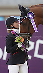 Paralympics London 2012 - ParalympicsGB - Equestrian Dressage Individual, Ind. Championship Test - Grade IV..Sophie Wells with her horse Pinocchio celebrate winning the Silver Medal in the  Individual, Ind. Championship Test - Grade IV  2nd September 2012 at the Paralympic Games in London. (Photo: (Richard Washbrooke)/ParalympicsGB)