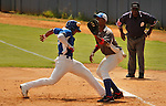 """Major League Baseball prospect Ariel Rodriguez slides in safely during the final game of the """"Torneo Supremo"""" at the Quiskeya National Stadium in Santo Domingo. The Tournament which aims to maximize the ability of Major League Baseball organizations to scout in the Dominican Republic. According to the MLB's office in the Dominican Republic, this year, the tournament introduced 23 new baseball prospects. July 29 2011. ViewPress/ Kena Betancur"""
