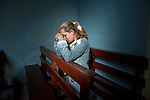 BRAZIL-10041, Brazil, Latin America, Lavazza, 08/2010, a young girl praying in a chapel<br />