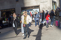 Crowds of shoppers on Fifth Avenue in Midtown Manhattan in New York on Sunday, November 27, 2016. The National Retail Federation reported that 43.8% of consumers shopped online during the four-day weekend.  (© Richard B. Levine)