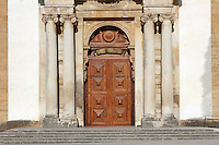 Main entrance to the Joanina Library, or Biblioteca Joanina, a Baroque library built 1717-28 by Gaspar Ferreira, part of the University of Coimbra General Library, with panelled wooden door topped by an arch, and flanked by 4 columns with Ionic capitals, in Coimbra, Portugal. The Casa da Livraria was built during the reign of King John V or Joao V, and consists of the Green Room, Red Room and Black Room, with 250,000 books dating from the 16th - 18th centuries. The library is part of the Faculty of Law and the University is housed in the buildings of the Royal Palace of Coimbra. The building is classified as a national monument and UNESCO World Heritage Site. Picture by Manuel Cohen