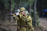 """An actor dressed as a historical Japanese army officer shoots a fake gun on the set of """"The Last Prince"""" television series at Hengdian World Studios in Hengdian July 23, 2015. There are eleven productions about the war against Japan being filmed at Hengdian World Studios. The facility itself, located in China's Zheijang province, is the biggest movie lot ever built. Director Li Xiaoqiang said the series is about a Qing Dynasty prince, who joined the Chinese nationalist army after suffering family misfortune. """"After he learnt more about the Communist Party, the prince began to understand what real revolution and the anti-Japanese war meant, and turned to the Communist Party to fight Japan"""", the director added. According to local media, more than 10 new movies, 12 TV dramas, 20 documentaries and 183 war-themed stage performances will be released in China to coincide with the 70th anniversary of the end of World War Two. REUTERS/Damir SagoljPICTURE 13 OF 28 FOR WIDER IMAGE STORY """"BEHIND THE SCENES OF A CHINESE WAR DRAMA"""".SEARCH """"SAGOLJ STUDIO"""" FOR ALL PICTURES."""
