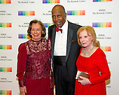 Ann Jordan, left, Vernon Jordan, center, and Buffy Cafritz, right, arrive for the formal Artist's Dinner honoring the recipients of the 39th Annual Kennedy Center Honors hosted by United States Secretary of State John F. Kerry at the U.S. Department of State in Washington, D.C. on Saturday, December 3, 2016. The 2016 honorees are: Argentine pianist Martha Argerich; rock band the Eagles; screen and stage actor Al Pacino; gospel and blues singer Mavis Staples; and musician James Taylor.<br /> Credit: Ron Sachs / Pool via CNP
