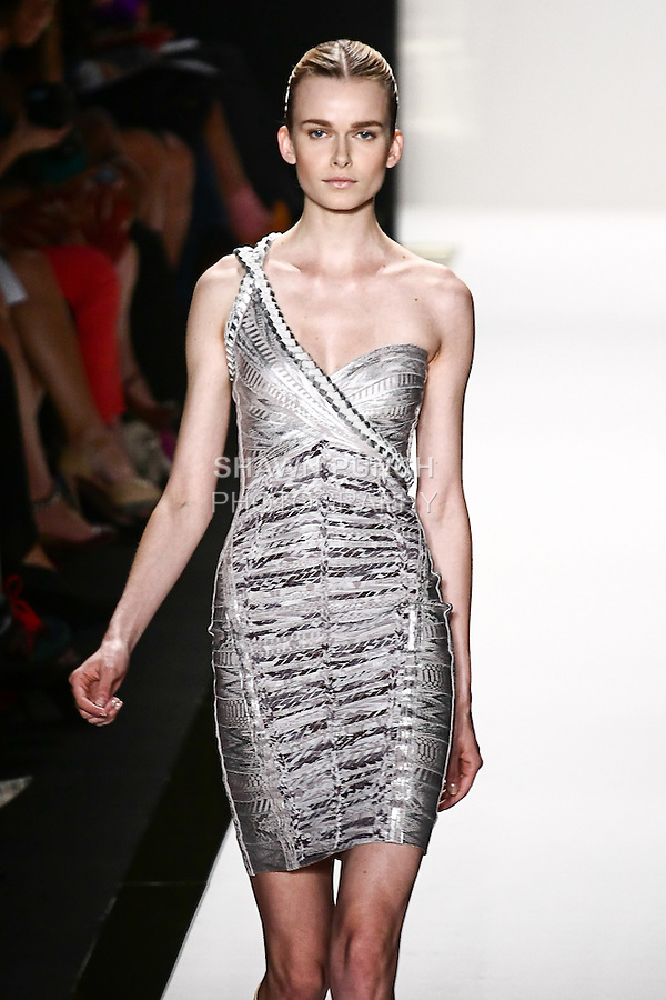 Karo Mrozkova walks the runway in a silver foil bandage dress with braiding technique, and vapor gladiator boot, by Max Azria for the Herve Leger by Max Azria Spring 2012 fashion show, during Mercedes-Benz Fashion Week Spring 2012.