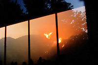Santa Barbara, Calif., May 5, 2009 - A view of the Jesusita Fire from a home in Mission Canyon north of Foothill Road. According to David Sadecki with the Santa Barbara County Fire Department, the fire began at around 1:45 pm today near the popular Jesusita Trail near Inspiration Point in San Roque Canyon. As of midnight more than 420 acres had burned and about 1,000 homes were evacuated, with about 2,000 threatened.