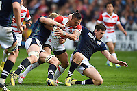 Male Sa'u of Japan takes on the Scotland defence. Rugby World Cup Pool B match between Scotland and Japan on September 23, 2015 at Kingsholm Stadium in Gloucester, England. Photo by: Patrick Khachfe / Onside Images