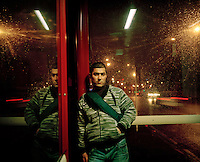 20 year old Brzo from Iraqi Kurdistan waits at a bus stop in Leeds. His asylum claim was refused and with no support he sleeps in a squat in Leeds. Brzo is one of an estimated 300,000 rejected asylum seekers living in the UK.