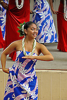 Women wearing shell lei perform  hula at Ward Warehouse shopping center in Honolulu, O'ahu.
