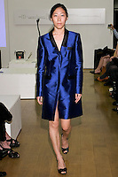 85 Broads member walks runway in an FW11 Royal Blue mini jacket dress by Yuna Yang, during the 85 Broads Presents Yuna Yang trunk show at Art Gate Gallery on October 24th 2011.