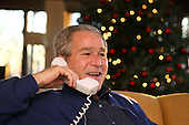 President George W. Bush makes Christmas Eve telephone calls to members of the Armed Forces at Camp David, Monday, Dec. 24, 2007. White House Photo by Eric Draper.
