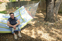 NWA Democrat-Gazette/FLIP PUTTHOFF<br /> Brock Short enjoys spending time    Sept. 8 2015 in his backyard patio area, relaxing in his hammock or at the campfire ring.