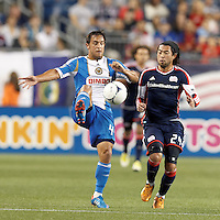 Philadelphia Union midfielder Daniel Cruz (44) collects a pass as New England Revolution midfielder Lee Nguyen (24) closes. In a Major League Soccer (MLS) match, the New England Revolution tied Philadelphia Union, 0-0, at Gillette Stadium on September 1, 2012.