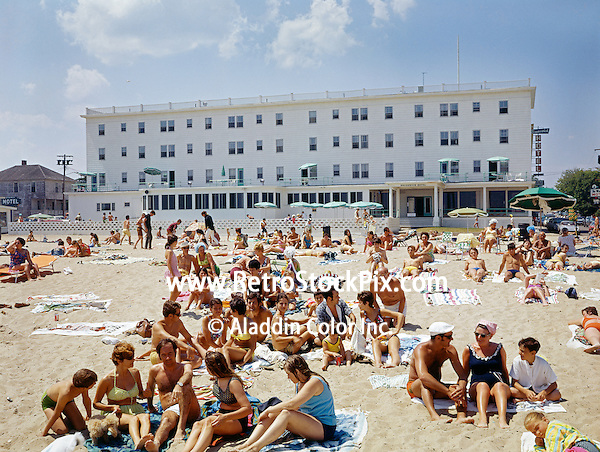 Brunswick Hotel, Old Orchard Beach, Maine. Large group of vacationers on the beach in front of the hotel.