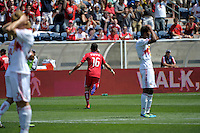 Chicago midfielder Marco Pappa (16) celebrates after scoring the game-tying goal while New York players react in disbelief.  The Chicago Fire tied the New York Red Bulls 1-1 at Toyota Park in Bridgeview, IL on June 26, 2011.