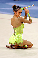 August 29, 2004; Athens, Greece; Rhythmic gymnastics star ALMUDENA CID of Spain smiles at finish of her clubs routine in All-Around competition at 2004 Athens Olympics. Almudena Cid has made history by being the only rhythmic gymnast ever to make 3 Olympic finals.<br />