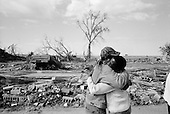New Orleans, Louisianna.USA.December 1, 2005 ..Hurricane Katrina damage and recovery. Residents of the Lower Ninth Ward return to their homes for the first time. This resident looks at the place that was once her home. A car landed in her living room, or what is left of it.