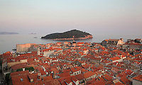 View over the rooftops of the medieval walled city with Lokrum island behind, Dubrovnik, Croatia. The city developed as an important port in the 15th and 16th centuries and has had a multicultural history, allied to the Romans, Ostrogoths, Byzantines, Ancona, Hungary and the Ottomans. In 1979 the city was listed as a UNESCO World Heritage Site. Picture by Manuel Cohen