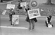 23 Oct 1972 --- Women activists protesting with images of children wounded during the war in Vietnam along the route of Richard Nixon's cortege in Westchester, a New York suburb. Republican President Richard Nixon is campaigning for Presidential re-election against the Democratic candidate Senator George McGovern. --- Image by © JP Laffont/Sygma/Corbis