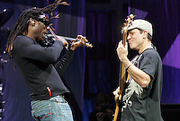 Boyd Tinsley, left, jams with Steffan Lasard, right, during the sold-out Dave mathews Band concert at the John Paul Jones Arena Friday in Charlottesville, VA.