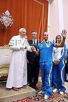 Pope Benedict XVI shakes hands with Italy's Valerio Cleri, gold medalist in the men's 25-kilometer open water competition during the audience for the competitors at his summer residence in Castelgandolfo south of Rome on August 1, 2009.